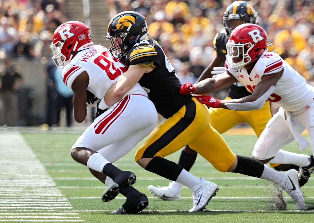 Iowa Hawkeyes linebacker Nick Niemann (49) makes a tackle during the second quarter of their Big Ten Conference football game at Kinnick Stadium in Iowa City on Saturday, Sep 7, 2019. (Stephen Mally/hawkeyesports.com)