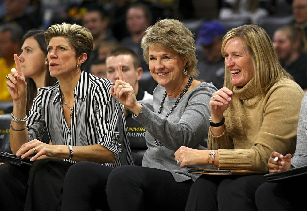 Iowa associate head coach Jan Jensen, head coach Lisa Bluder, and special assistant to the head coach Jenni Fitzgerald on the bench during the fourth quarter of their game against Winona State at Carver-Hawkeye Arena in Iowa City on Sunday, Nov 3, 2019. (Stephen Mally/hawkeyesports.com)