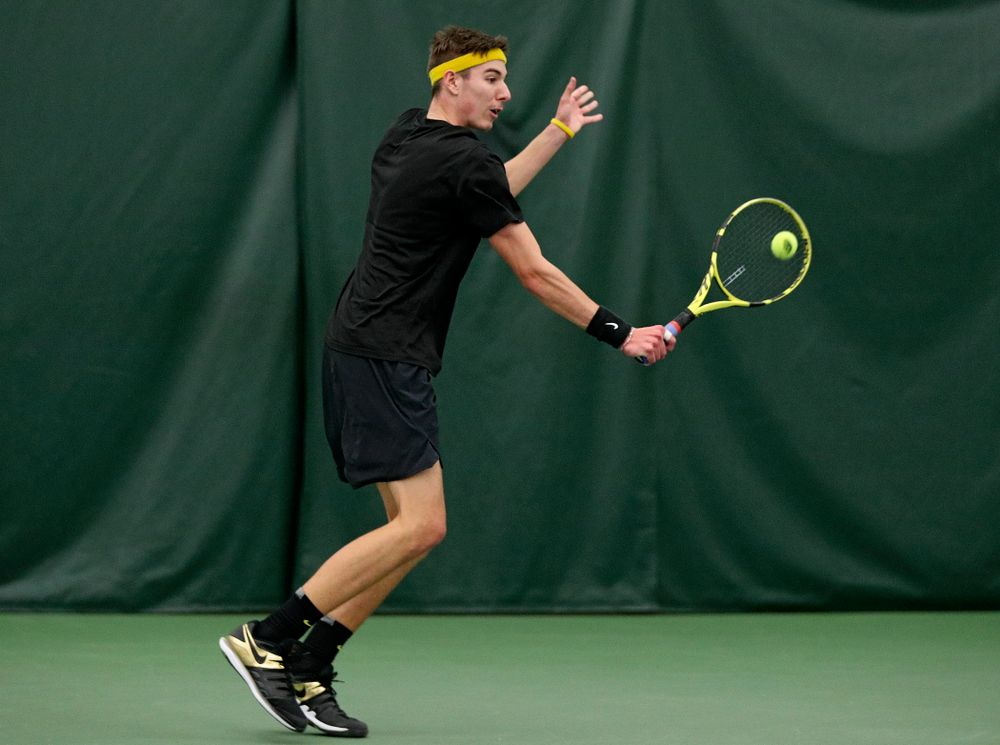 Iowa's Nikita Snezhko returns a shot during his doubles match at the Hawkeye Tennis and Recreation Complex in Iowa City on Thursday, January 16, 2020. (Stephen Mally/hawkeyesports.com)