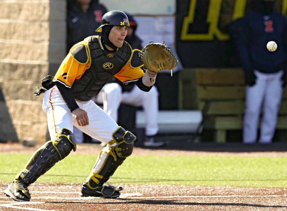 Iowa Hawkeyes catcher Austin Martin (34) pulls in a throw at the plate in the middle of an inning ending double play during the eighth inning against Illinois at Duane Banks Field in Iowa City on Sunday, Mar. 31, 2019. (Stephen Mally/hawkeyesports.com)