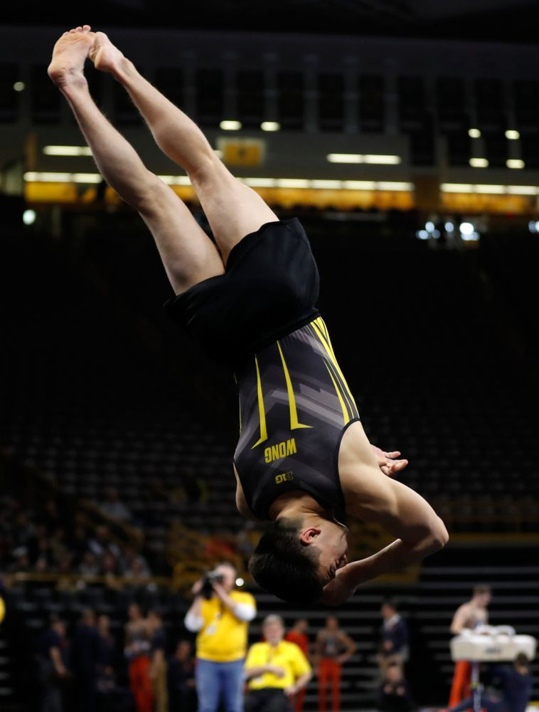Brandon Wong competes on the floor against Illinois