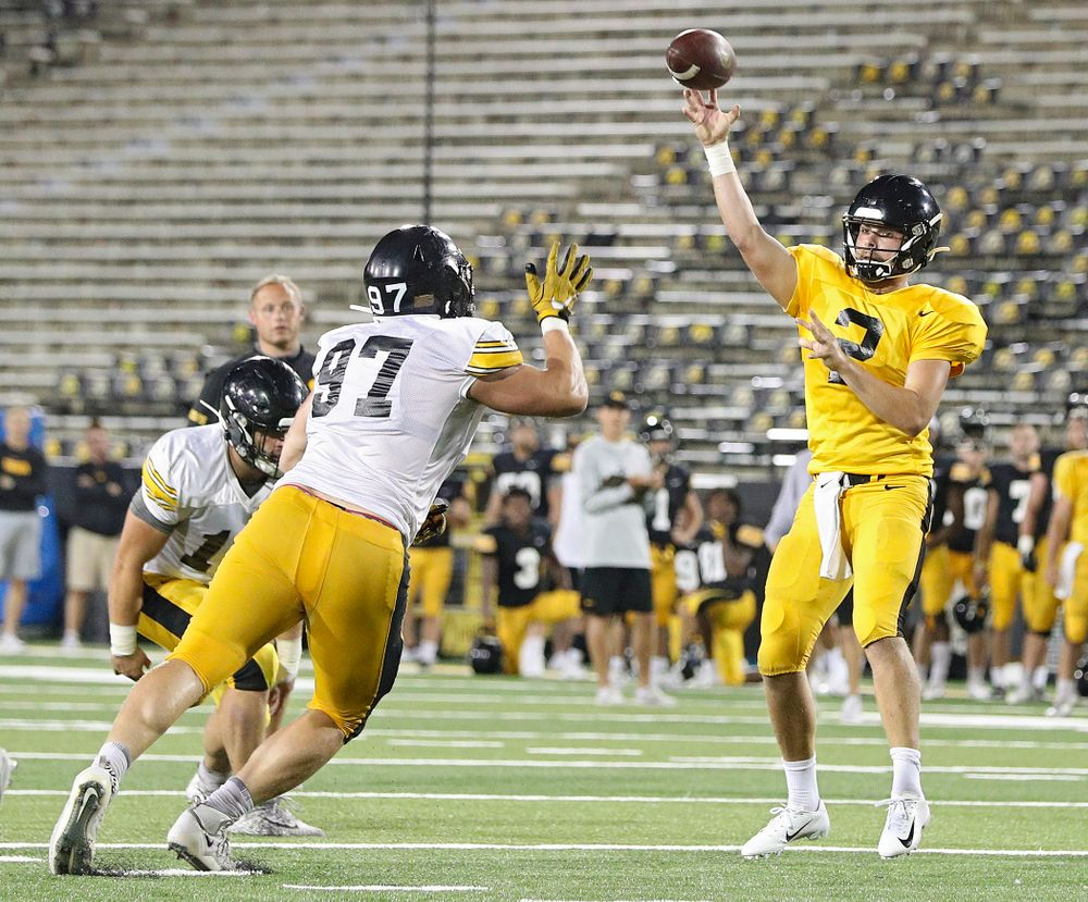 Iowa Hawkeyes quarterback Peyton Mansell (2) throws a pass over defensive lineman Zach VanValkenburg (97) during Fall Camp Practice No. 12 at Kinnick Stadium in Iowa City on Thursday, Aug 15, 2019. (Stephen Mally/hawkeyesports.com)