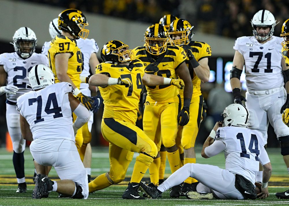 Iowa Hawkeyes defensive lineman Austin Schulte (74) celebrates after bringing down Penn State Nittany Lions quarterback Sean Clifford (14) for a loss during the first quarter of their game at Kinnick Stadium in Iowa City on Saturday, Oct 12, 2019. (Stephen Mally/hawkeyesports.com)