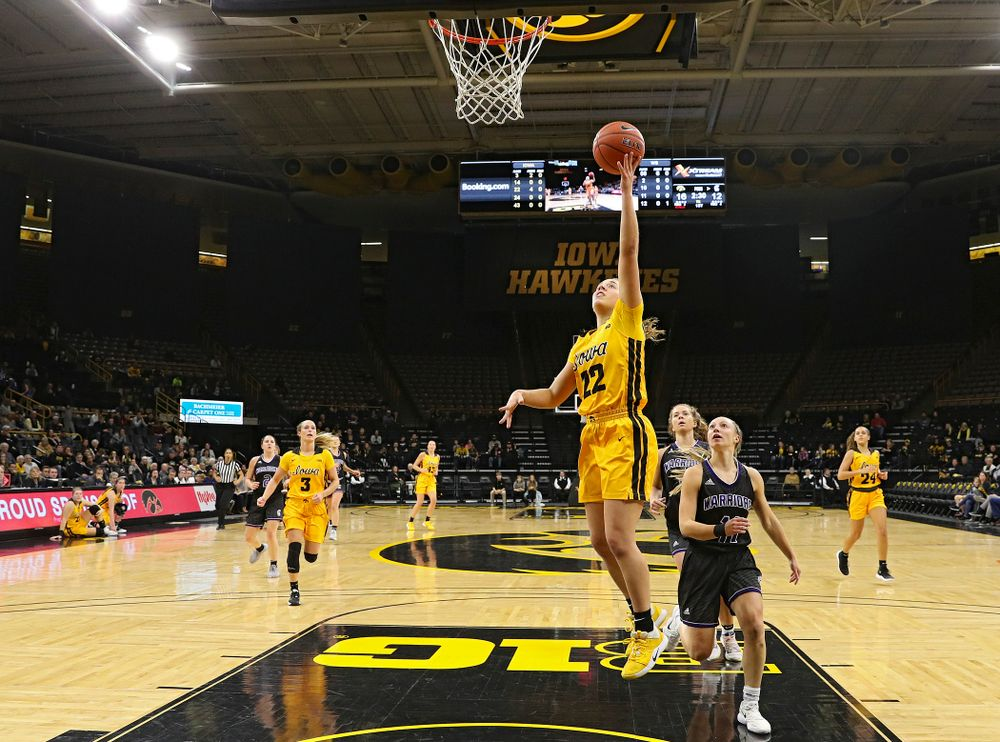 Iowa guard Kathleen Doyle (22) makes a basket during the first quarter of their game against Winona State at Carver-Hawkeye Arena in Iowa City on Sunday, Nov 3, 2019. (Stephen Mally/hawkeyesports.com)