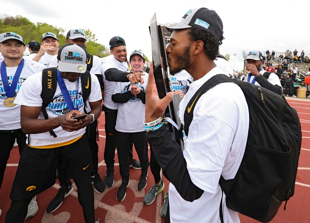 Iowa's Mar'yea Harris kisses their team trophy as he celebrates with teammates after winning the Men's Big Ten Outdoor Track and Field Championships on the third day of the Big Ten Outdoor Track and Field Championships at Francis X. Cretzmeyer Track in Iowa City on Sunday, May. 12, 2019. (Stephen Mally/hawkeyesports.com)