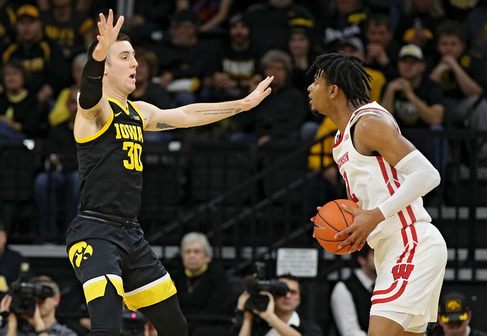 Iowa Hawkeyes guard Connor McCaffery (30) defends during the first half of their game at Carver-Hawkeye Arena in Iowa City on Monday, January 27, 2020. (Stephen Mally/hawkeyesports.com)