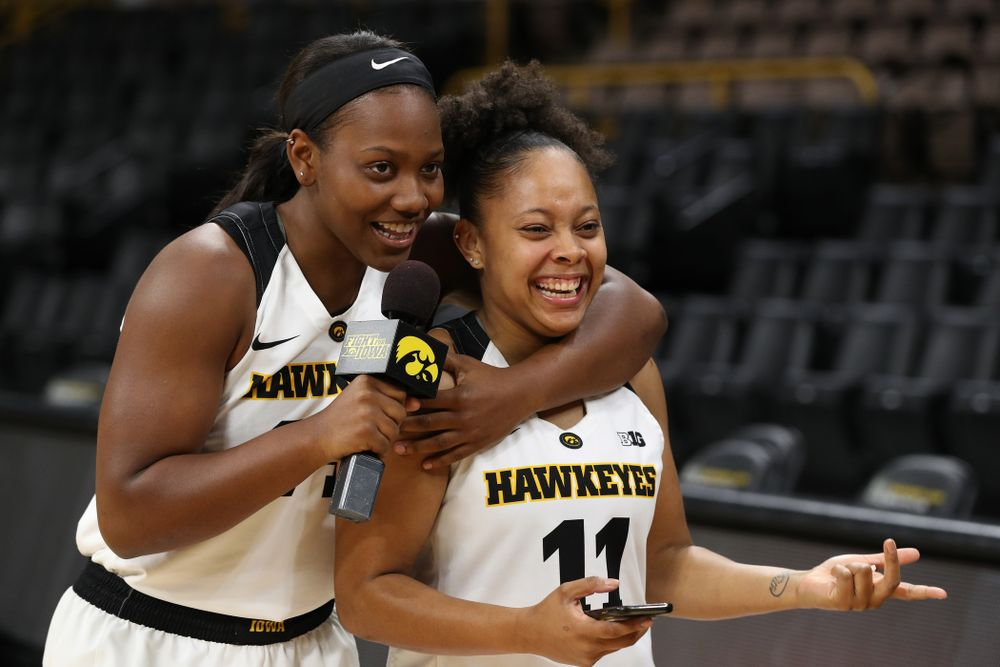 Iowa Hawkeyes guard Zion Sanders (24) interviews guard Tania Davis (11) for a Facebook Live during the team's annual media day Wednesday, October 31, 2018 at Carver-Hawkeye Arena. (Brian Ray/hawkeyesports.com)