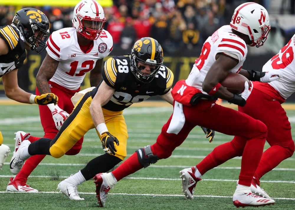 Iowa Hawkeyes defensive back Jack Koerner (28) makes a tackle on a kickoff