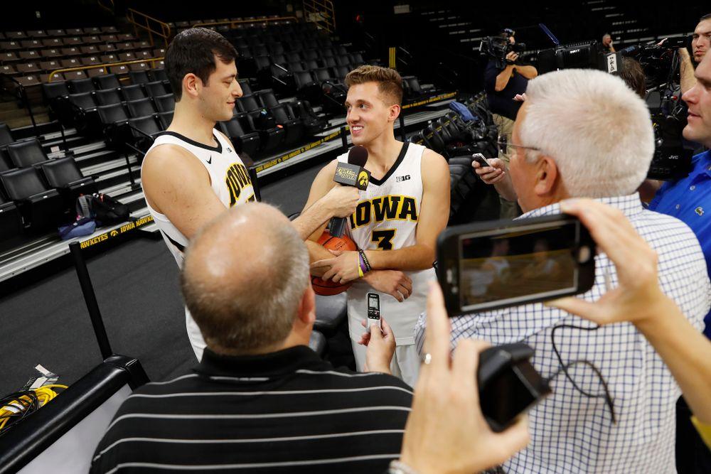 Iowa Hawkeyes forward Ryan Kriener (15) and guard Jordan Bohannon (3) during the team's annual media day Monday, October 8, 2018 at Carver-Hawkeye Arena. (Brian Ray/hawkeyesports.com)