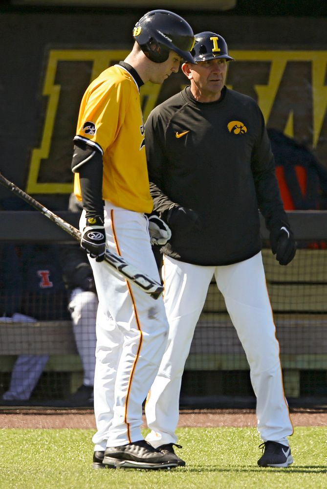 Iowa Hawkeyes Connor McCaffery (30) talks with head coach Rick Heller during the third inning against Illinois at Duane Banks Field in Iowa City on Sunday, Mar. 31, 2019. (Stephen Mally/hawkeyesports.com)