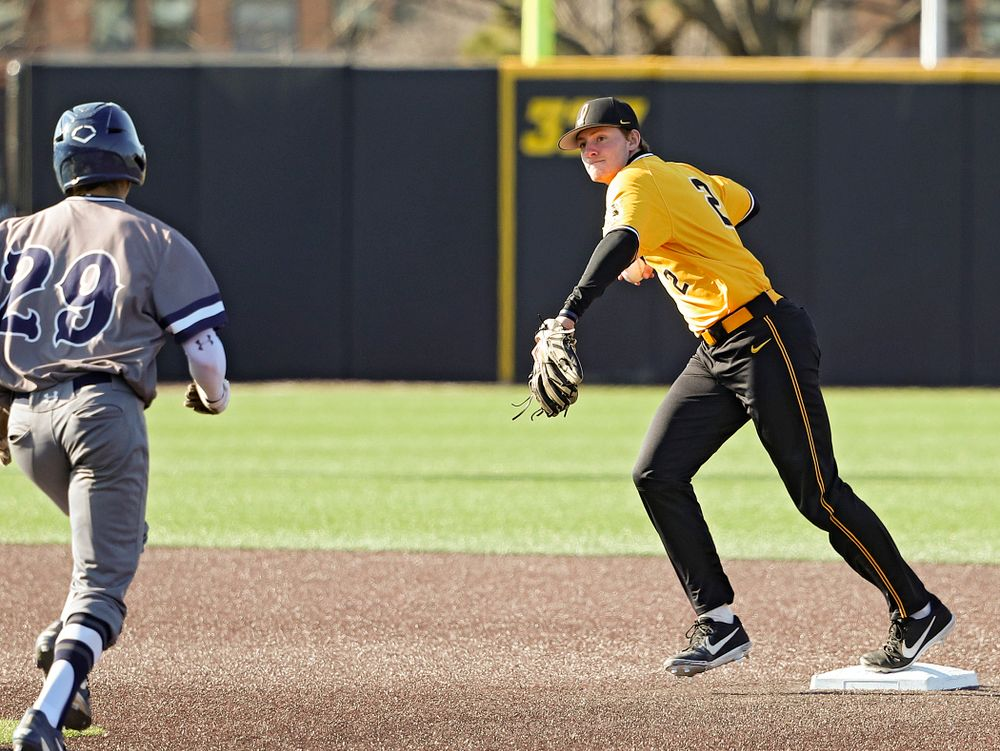 Iowa Hawkeyes shortstop Brendan Sher (2) steps on second base before throwing to first base while turning a double play during the third inning of their game at Duane Banks Field in Iowa City on Tuesday, Apr. 2, 2019. (Stephen Mally/hawkeyesports.com)