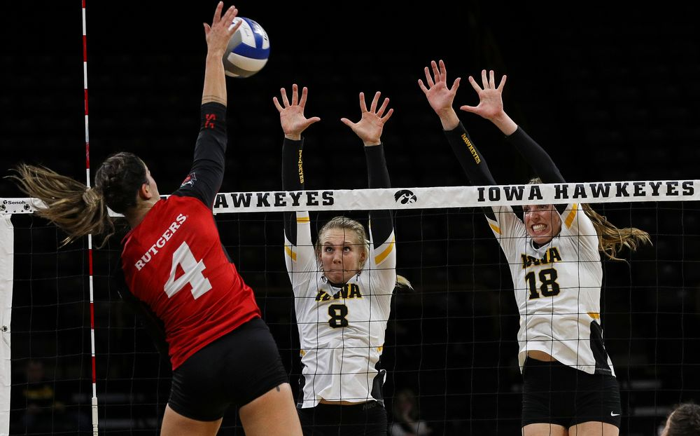 Iowa Hawkeyes right side hitter Reghan Coyle (8) and Iowa Hawkeyes middle blocker Hannah Clayton (18) go up for a block during a match against Rutgers at Carver-Hawkeye Arena on November 2, 2018. (Tork Mason/hawkeyesports.com)