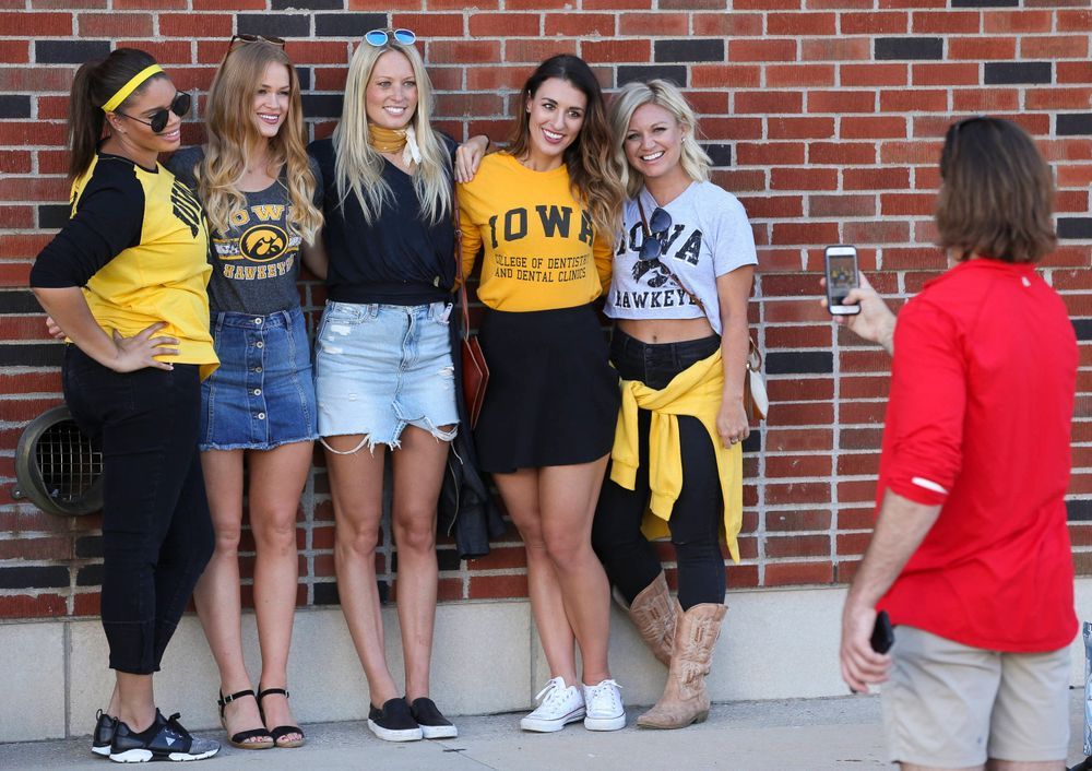 Fans pose for photos before a game against Wisconsin on September 22, 2018.