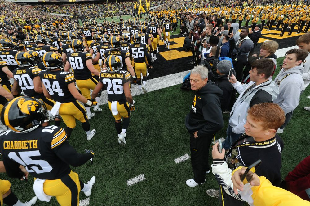 Iowa Hawkeyes head coach Kirk Ferentz watches as his team swarms the field for their game against the Purdue Boilermakers Saturday, October 19, 2019 at Kinnick Stadium. (Brian Ray/hawkeyesports.com)