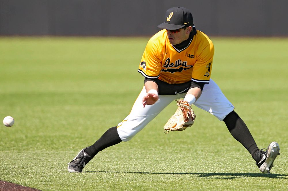 Iowa Hawkeyes second baseman Mitchell Boe (4) fields a ground ball during the fifth inning against Illinois at Duane Banks Field in Iowa City on Sunday, Mar. 31, 2019. (Stephen Mally/hawkeyesports.com)