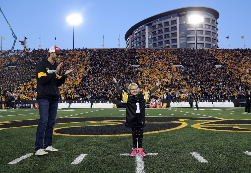 Honorary Captain Ricky Stanzi and Stead Family ChildrenÕs Hospital Kid Captain Gabby Yoder before the Iowa Hawkeyes game against the Penn State Nittany Lions Saturday, October 12, 2019 at Kinnick Stadium. (Brian Ray/hawkeyesports.com)