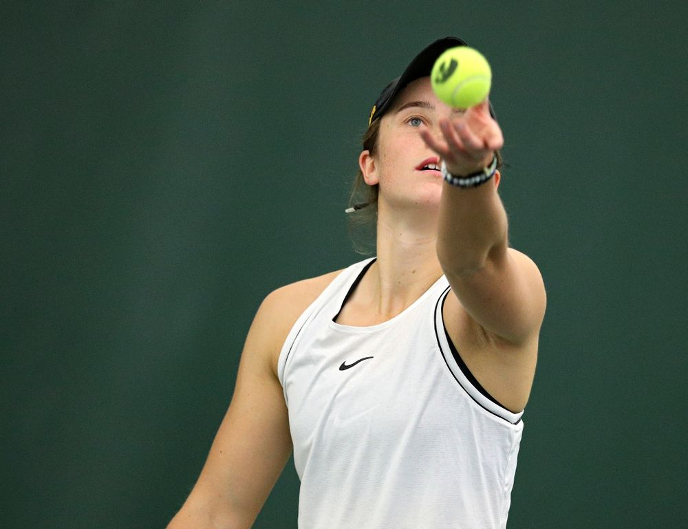 Iowa's Elise Van Heuvelen serves during her singles match at the Hawkeye Tennis and Recreation Complex in Iowa City on Sunday, February 16, 2020. (Stephen Mally/hawkeyesports.com)