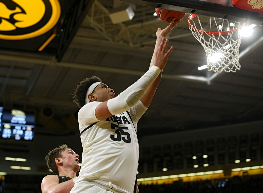 Iowa Hawkeyes forward Cordell Pemsl (35) scores a basket inside during the first half of their their game at Carver-Hawkeye Arena in Iowa City on Sunday, December 29, 2019. (Stephen Mally/hawkeyesports.com)