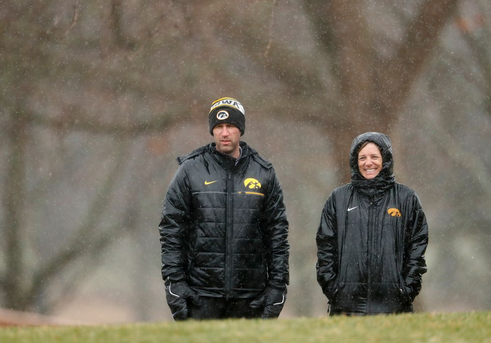 Iowa Men's Golf Head Coach Tyler Stith and Women's Golf Head Coach Megan Menzel watch the action  during day two of the 2018 Hawkeye Invitational Friday, April 13, 2018 at Finkbine Golf Course. (Brian Ray/hawkeyesports.com)