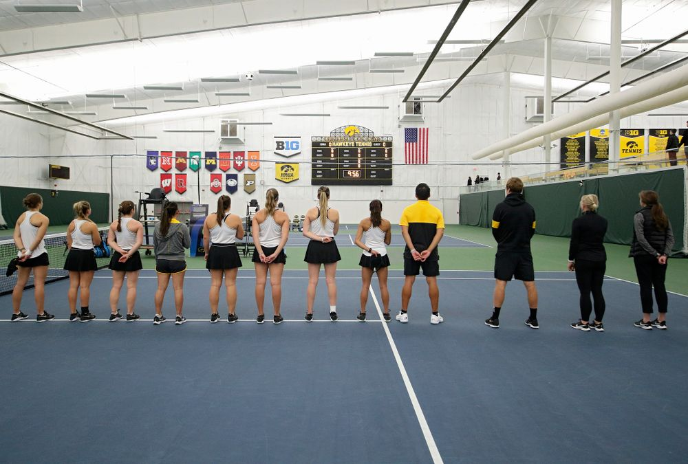 The Hawkeyes stand for the National Anthem before their match at the Hawkeye Tennis and Recreation Complex in Iowa City on Sunday, February 16, 2020. (Stephen Mally/hawkeyesports.com)