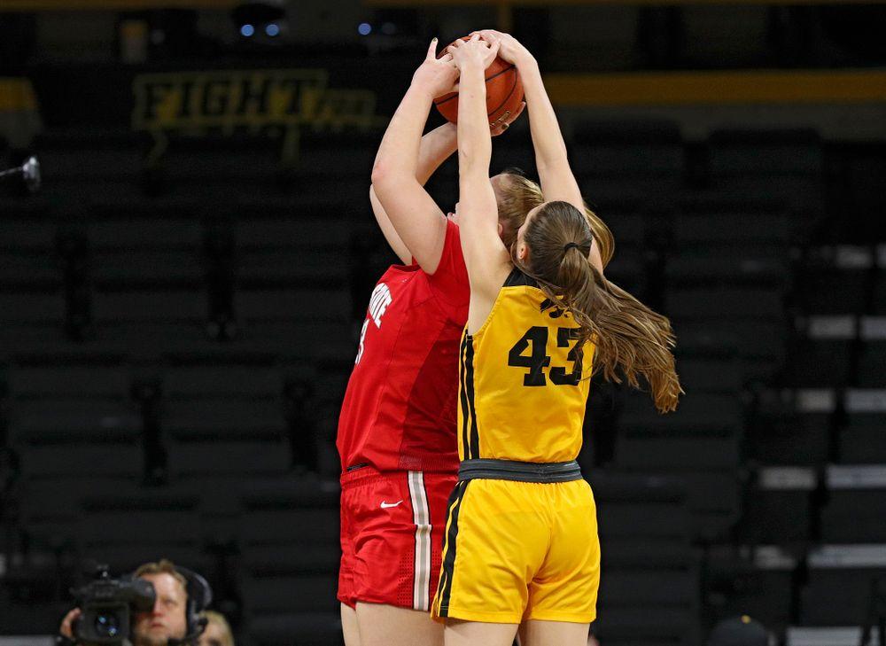 Iowa Hawkeyes forward Amanda Ollinger (43) blocks a shot by Ohio State Buckeyes forward Rebeka Mikulasikova (23) during the third quarter of their game at Carver-Hawkeye Arena in Iowa City on Thursday, January 23, 2020. (Stephen Mally/hawkeyesports.com)