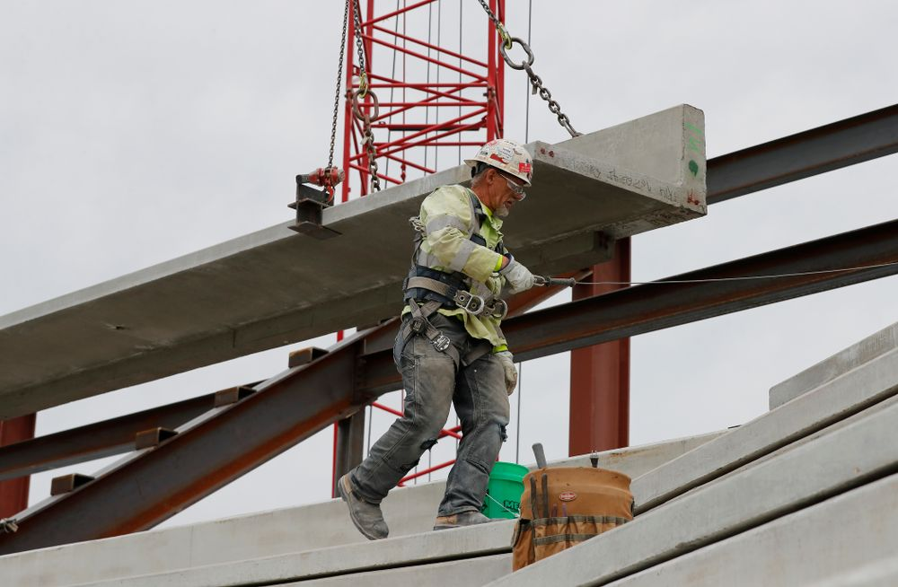 A section of precast concrete is lifted into place on the third deck of the north end zone Wednesday, June 6, 2018 at Kinnick Stadium. (Brian Ray/hawkeyesports.com)