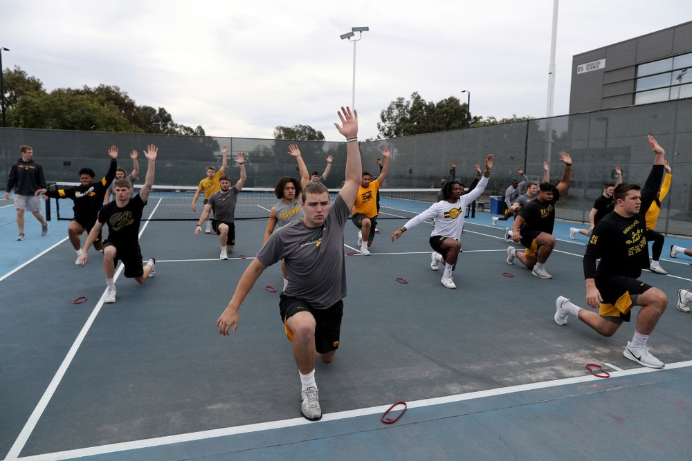 The Iowa Hawkeyes warm up for a lift before practice Sunday, December 22, 2019 at Mesa College in San Diego. (Brian Ray/hawkeyesports.com)