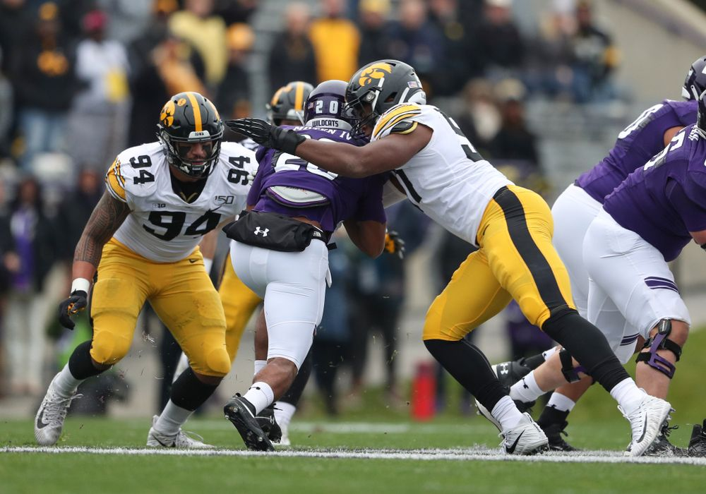 Iowa Hawkeyes defensive lineman Cedrick Lattimore (95) and defensive end A.J. Epenesa (94) against the Northwestern Wildcats Saturday, October 26, 2019 at Ryan Field in Evanston, Ill. (Brian Ray/hawkeyesports.com)