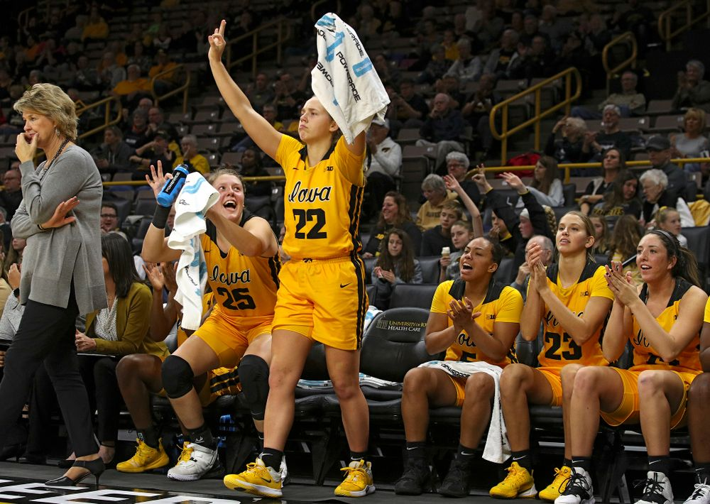 Iowa forward/center Monika Czinano (25) and guard Kathleen Doyle (22) celebrate after guard Makenzie Meyer (not pictured) made a 3-pointer during the fourth quarter of their game against Winona State at Carver-Hawkeye Arena in Iowa City on Sunday, Nov 3, 2019. (Stephen Mally/hawkeyesports.com)