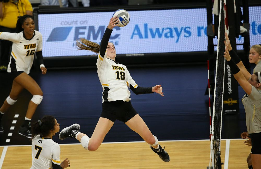 Iowa Hawkeyes middle blocker Hannah Clayton (18) spikes the ball during a game against Purdue at Carver-Hawkeye Arena on October 13, 2018. (Tork Mason/hawkeyesports.com)