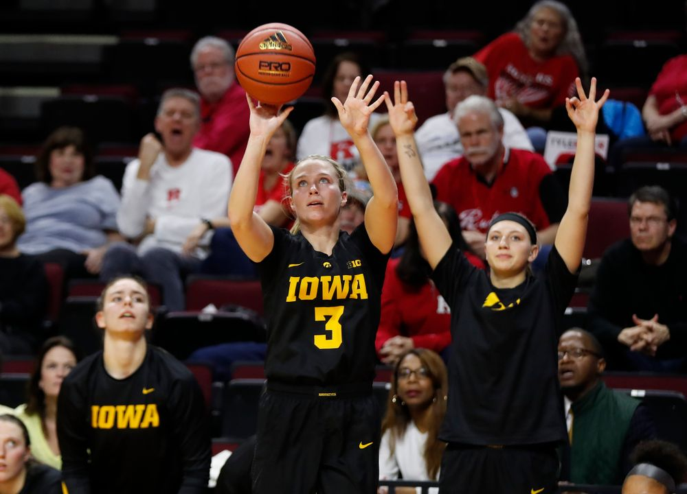 Iowa Hawkeyes guard Makenzie Meyer (3) and Carly Mohns