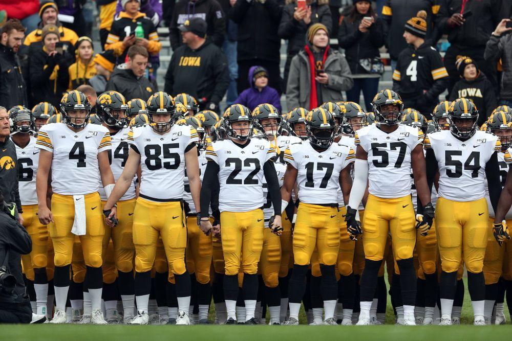 The Iowa Hawkeyes swarm the field against the Northwestern Wildcats Saturday, October 26, 2019 at Ryan Field in Evanston, Ill. (Brian Ray/hawkeyesports.com)
