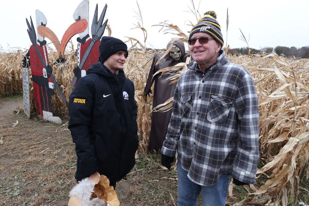 Gavin Teasdale talks with legendary former head coach Dan Gable during the teamÕs annual media day Wednesday, October 30, 2019 at Kroul Family Farms in Mount Vernon. (Brian Ray/hawkeyesports.com)