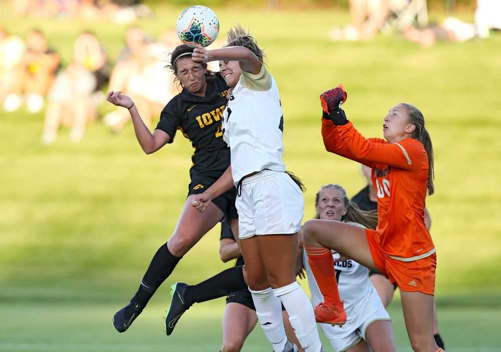 Iowa forward Kaleigh Haus (4) scores a goal with a header during the first half of their match against Western Michigan at the Iowa Soccer Complex in Iowa City on Thursday, Aug 22, 2019. (Stephen Mally/hawkeyesports.com)