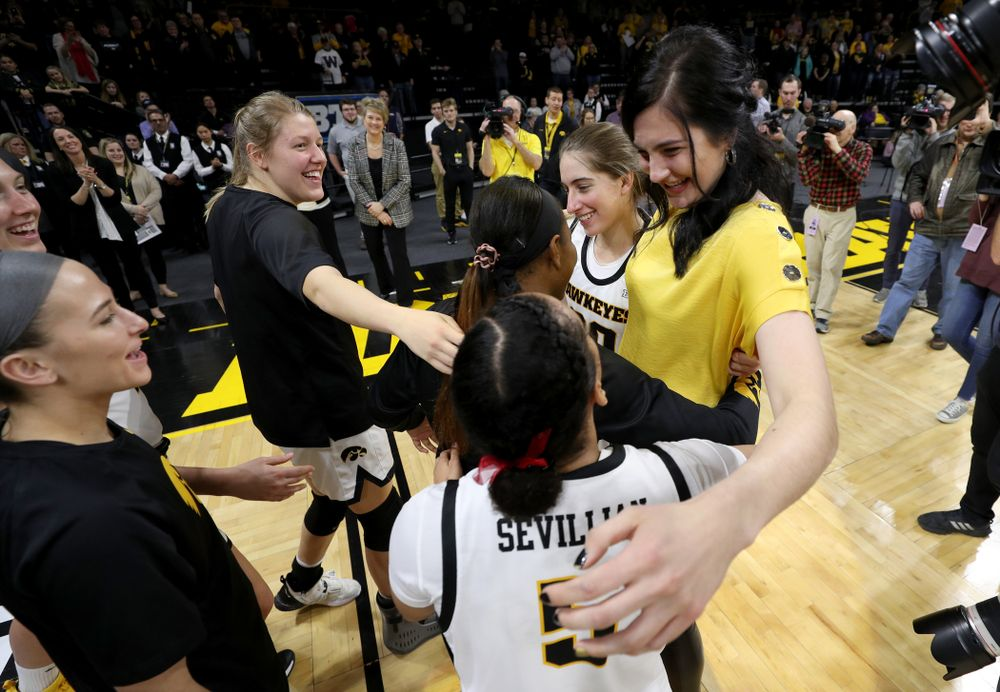 Megan Gustafson hugs her teammates after her number was raised into the rafters during a jersey retirement ceremony Sunday, January 26, 2020 at Carver-Hawkeye Arena. (Brian Ray/hawkeyesports.com)