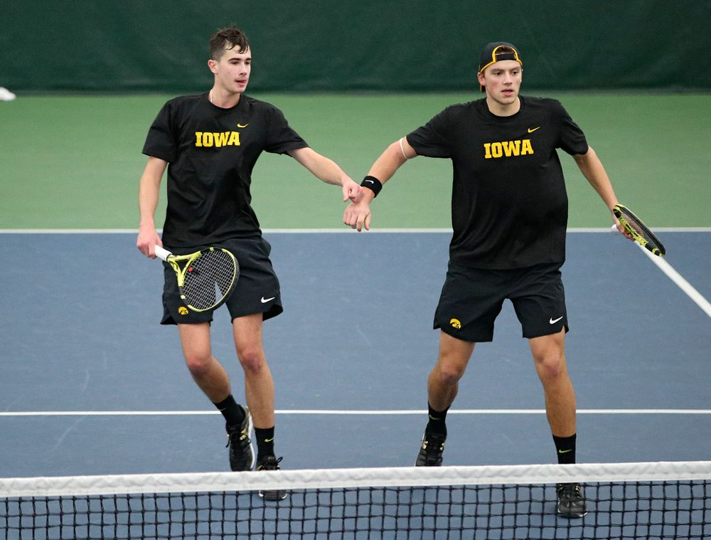 Iowa's Matt Clegg (from left) and Joe Tyler celebrate a point during their doubles match against Marquette at the Hawkeye Tennis and Recreation Complex in Iowa City on Saturday, January 25, 2020. (Stephen Mally/hawkeyesports.com)