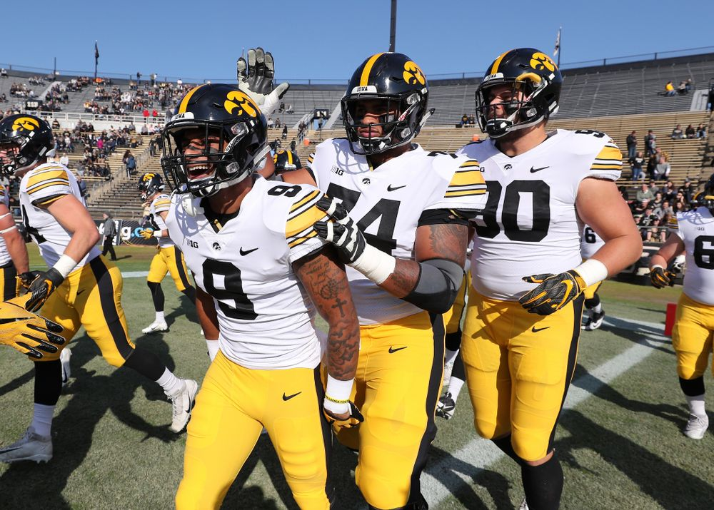 Iowa Hawkeyes defensive back Geno Stone (9) and offensive lineman Tristan Wirfs (74) against the Purdue Boilermakers Saturday, November 3, 2018 Ross Ade Stadium in West Lafayette, Ind. (Brian Ray/hawkeyesports.com)