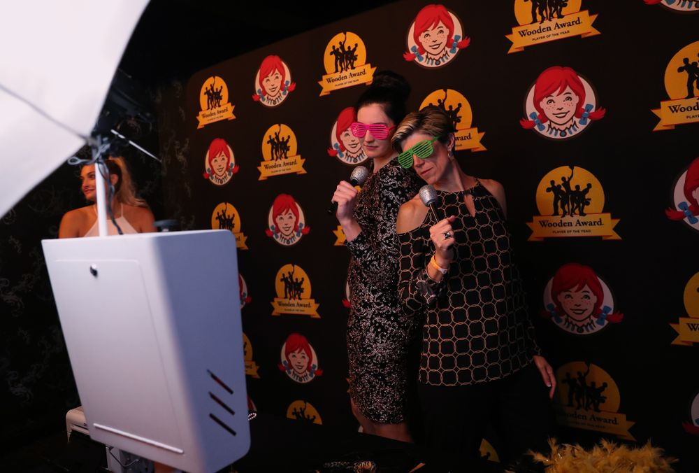 Iowa Hawkeyes forward Megan Gustafson (10) and associate head coach Jan Jensen in the photo booth at the after party for the ESPN College Basketball Awards show Friday, April 12, 2019 at The Novo at LA Live.  (Brian Ray/hawkeyesports.com)