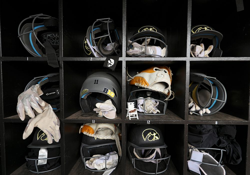 Batting helmets and gloves sit in the Iowa dugout before their game against Illinois at Pearl Field in Iowa City on Friday, Apr. 12, 2019. (Stephen Mally/hawkeyesports.com)
