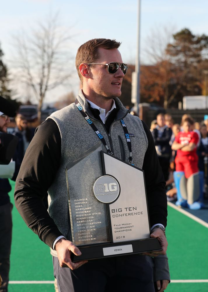 Former Hawkeye Football Player AJ Edds presents the trophy to the Iowa Hawkeyes following their victory over  Penn State in the 2019 Big Ten Field Hockey Tournament Championship Game Sunday, November 10, 2019 in State College. (Brian Ray/hawkeyesports.com)