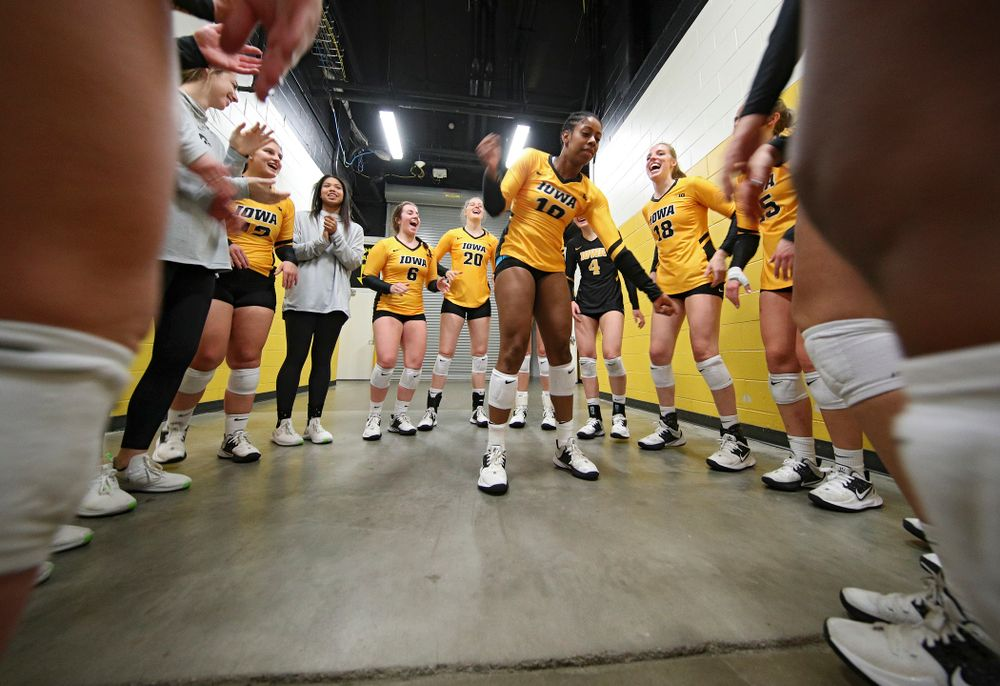 Iowa's Griere Hughes (10) dances in her team's huddle before their match against Illinois at Carver-Hawkeye Arena in Iowa City on Wednesday, Nov 6, 2019. (Stephen Mally/hawkeyesports.com)