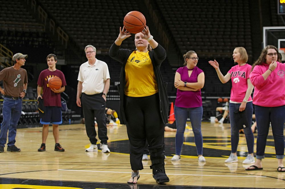 University of Iowa Hospitals and Clinics Adolescent and Young Adult (AYA) Cancer Program shoot baskets at Carver-Hawkeye Arena in Iowa City on Monday, Sep 30, 2019. (Stephen Mally/hawkeyesports.com)