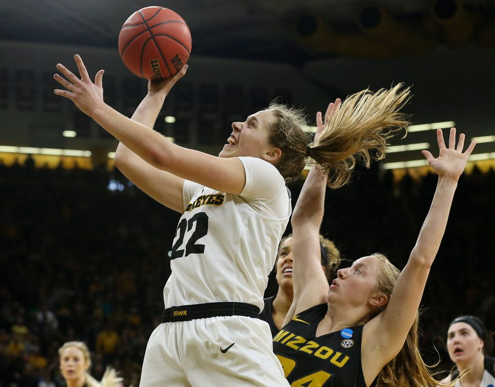 Iowa Hawkeyes guard Kathleen Doyle (22) scores a basket during the fourth quarter of their second round game in the 2019 NCAA Women's Basketball Tournament at Carver Hawkeye Arena in Iowa City on Sunday, Mar. 24, 2019. (Stephen Mally for hawkeyesports.com)