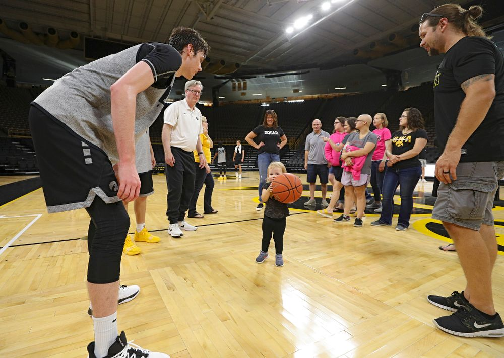 Iowa Hawkeyes forward Patrick McCaffery (22) talks with visitors from the University of Iowa Hospitals and Clinics Adolescent and Young Adult (AYA) Cancer Program after practice at Carver-Hawkeye Arena in Iowa City on Monday, Sep 30, 2019. (Stephen Mally/hawkeyesports.com)