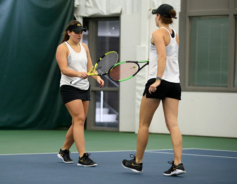 Iowa's Danielle Bauers (from left) celebrates with Elise Van Heuvelen during their doubles match at the Hawkeye Tennis and Recreation Complex in Iowa City on Sunday, February 23, 2020. (Stephen Mally/hawkeyesports.com)
