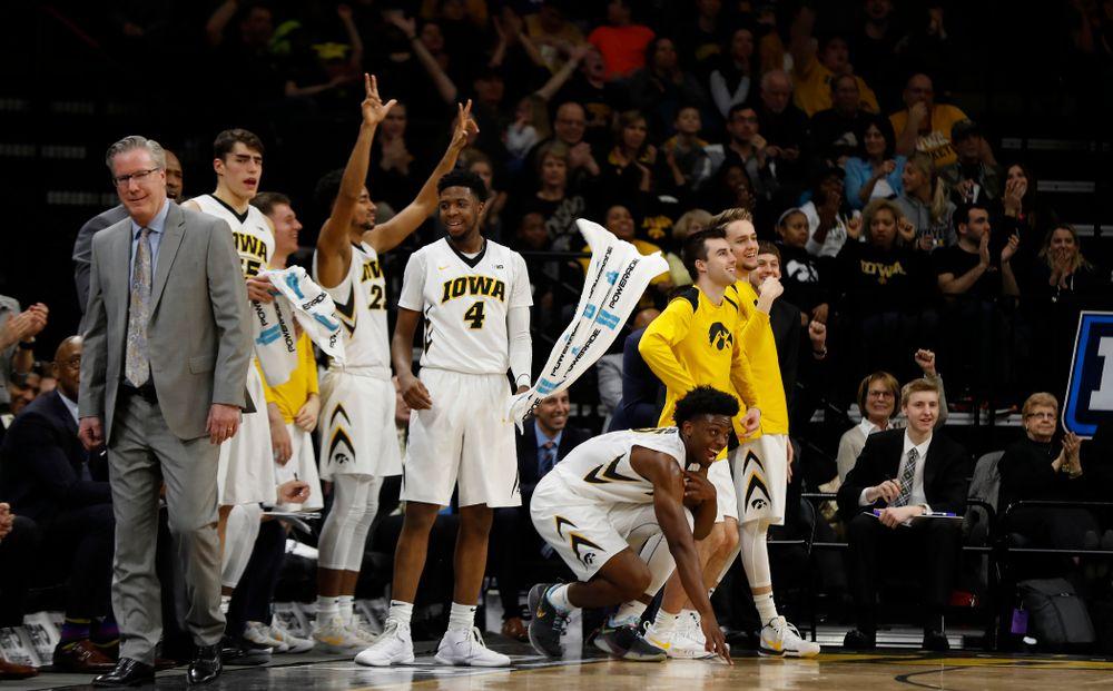The Iowa Hawkeyes celebrate a three point basket by guard Jordan Bohannon (3)