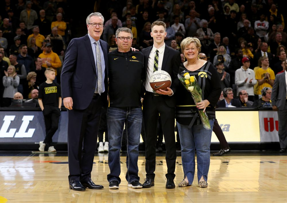Senior Student Manager Jarrett Knepper and his family during senior night festivities before their game against the Purdue Boilermakers Tuesday, March 3, 2020 at Carver-Hawkeye Arena. (Brian Ray/hawkeyesports.com)