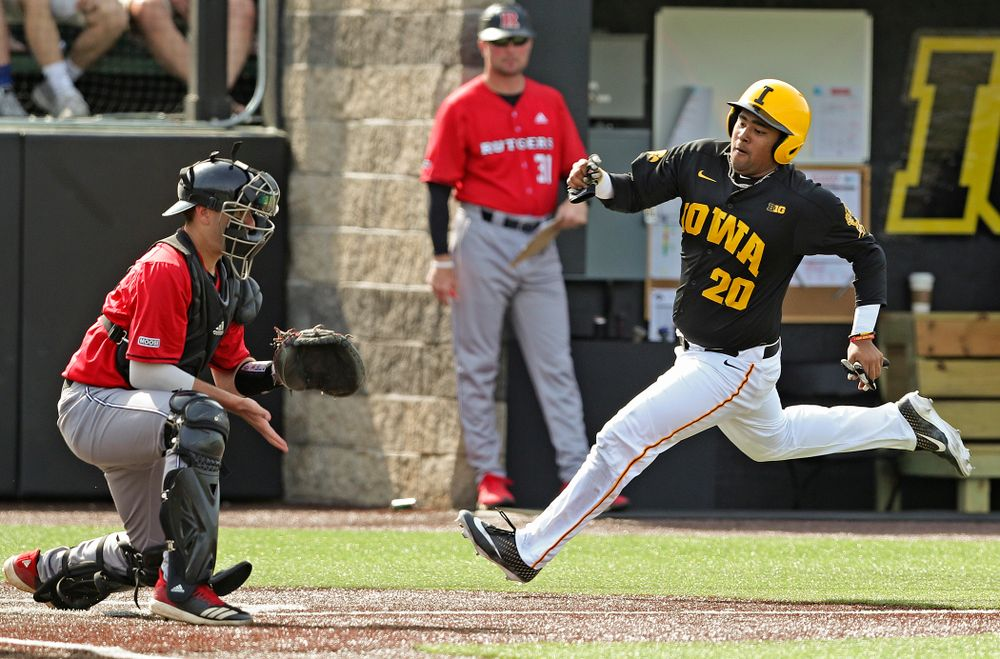 Iowa Hawkeyes designated hitter Izaya Fullard (20) scores a run during the sixth inning of their game against Rutgers at Duane Banks Field in Iowa City on Saturday, Apr. 6, 2019. (Stephen Mally/hawkeyesports.com)