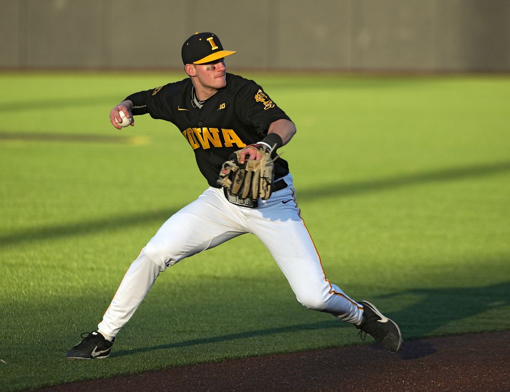 Iowa infielder Brendan Sher (2) throws to first during the fourth inning of their game at Duane Banks Field in Iowa City on Tuesday, March 3, 2020. (Stephen Mally/hawkeyesports.com)