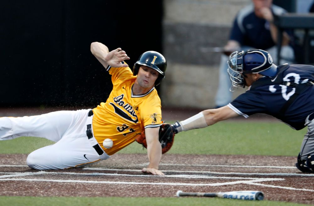 Iowa Hawkeyes outfielder Kace Massner (37) slides safely into home against the Penn State Nittany Lions Saturday, May 19, 2018 at Duane Banks Field. (Brian Ray/hawkeyesports.com)